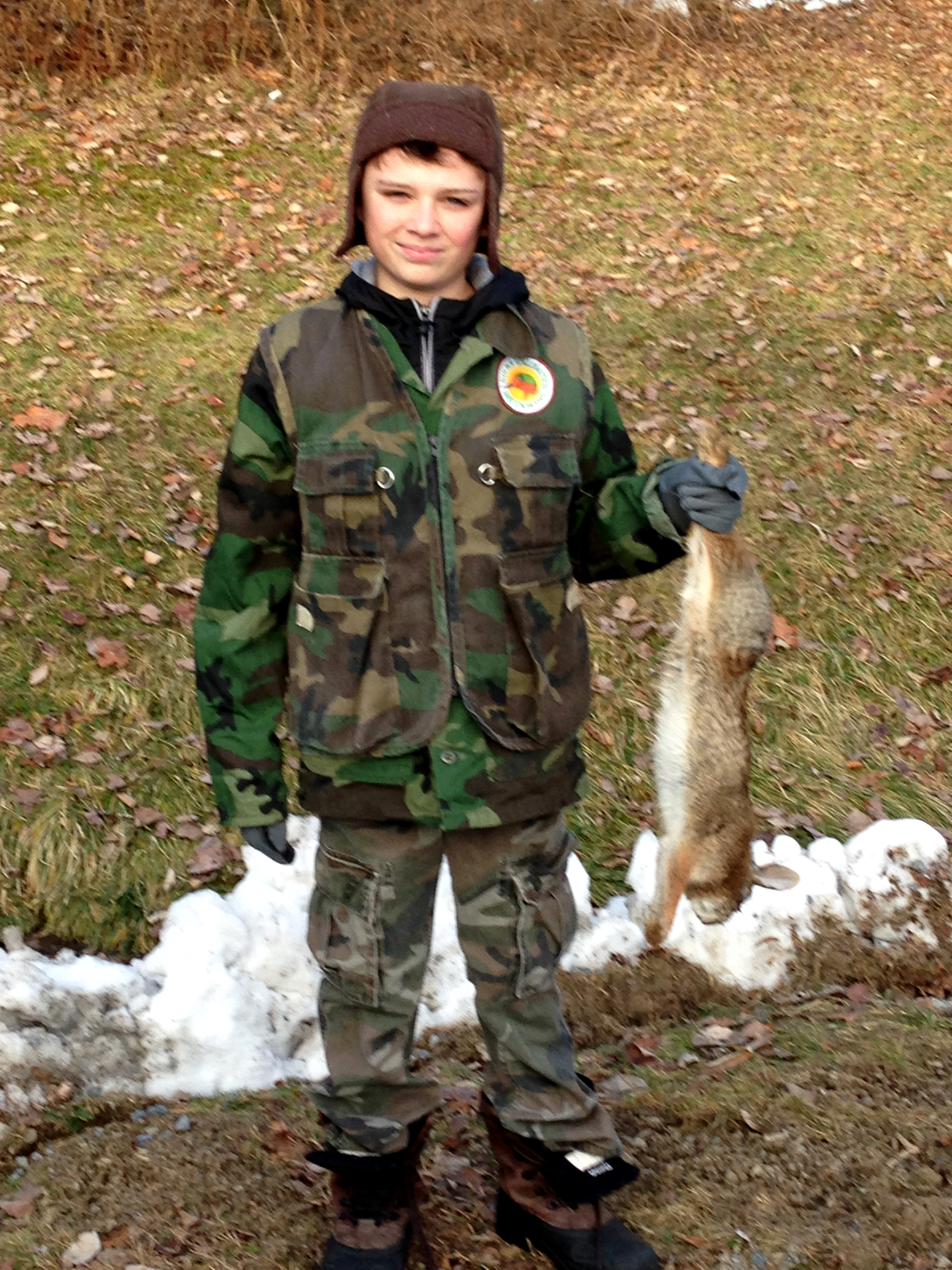 Holden with his first rabbit.