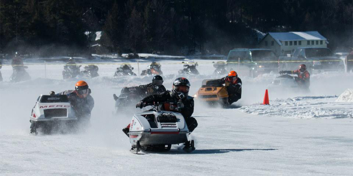 Vintage snowmobile races on Fourth Lake in Inlet