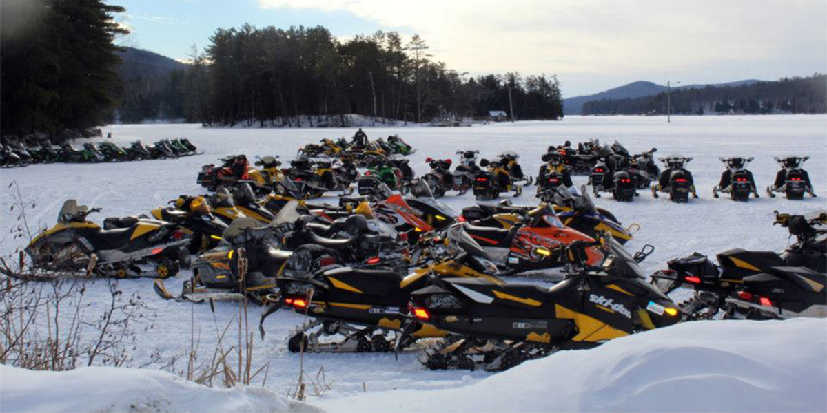 Sleds gather on Jennings Pond in Long Lake